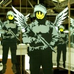 bansky-smiley-face-police-angels