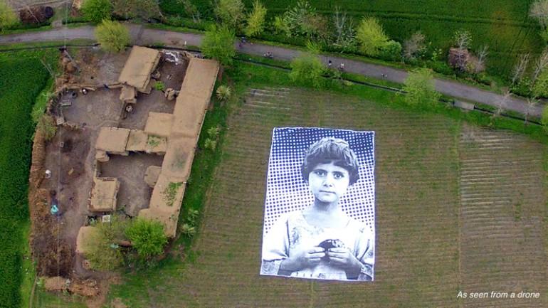 "Giant Portrait Shows Drone Operators That People Aren't ""Bug Splats"""