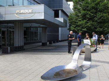 Art Arrest In Front Of Drug Manufacturer